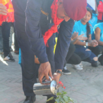 chief-guest-pitamber-adhikari-started-program-at-first-by-putting-water-in-flower